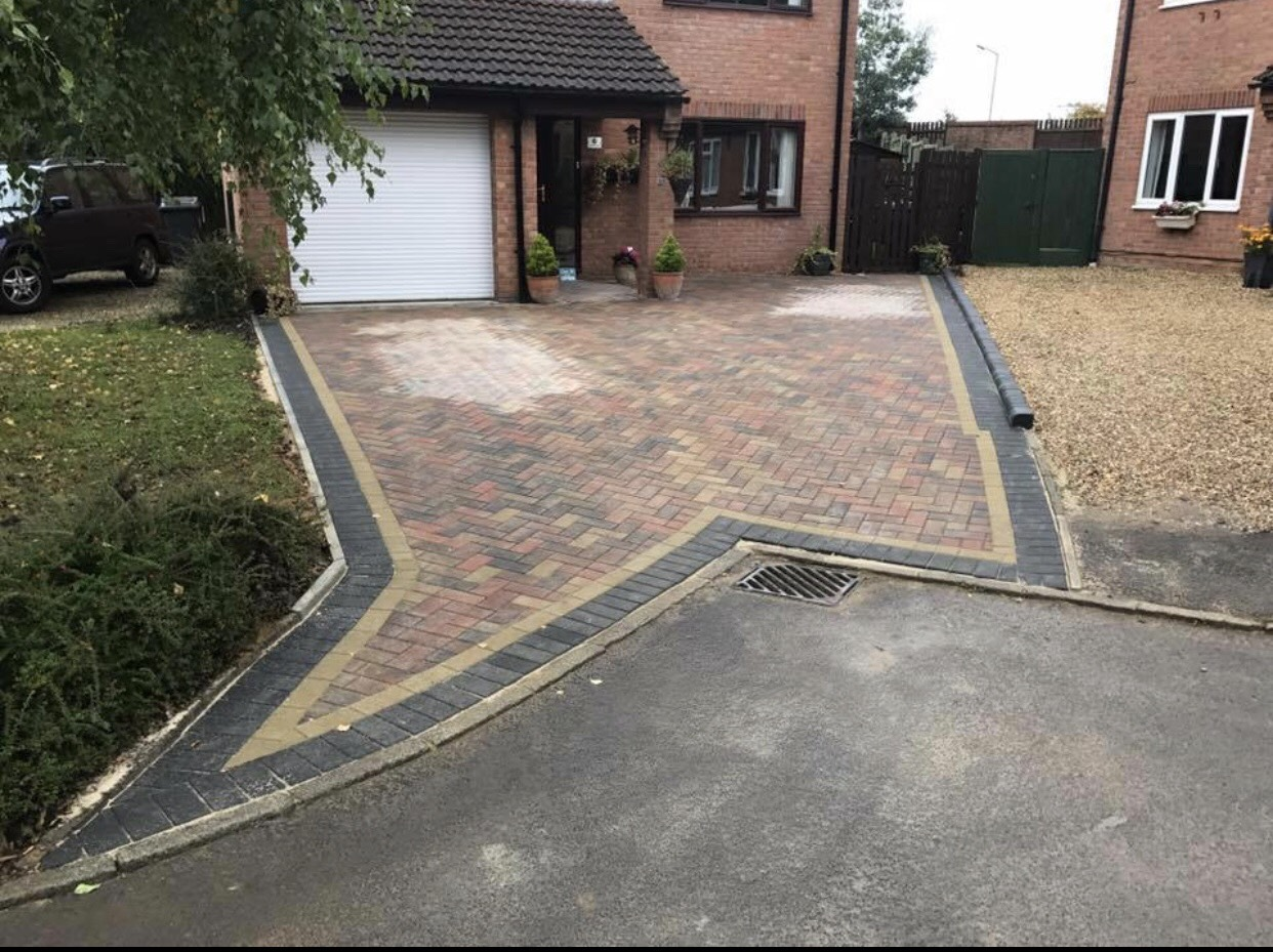 some work carried out last month for a bock paved driveway with a black border finished off to the road